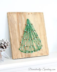 Love this simple, sweet string art Christmas tree from @Domestically Speaking