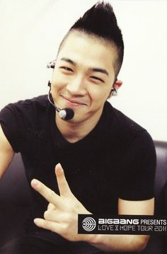 Taeyang - BIGBANG. It seems like forever ago that he has the black Mohawk. I thought it was permanently stuck to his head.