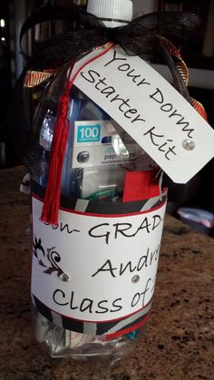 Graduation gift idea...simply cut a hole in the center of a 2 liter bottle, fill the bottle with small gifts, gift cards, etc.., cover the hole with a cute label,  and create tags on the computer. The tassel was made from embroidery floss.  Use high school colors for a personal touch.