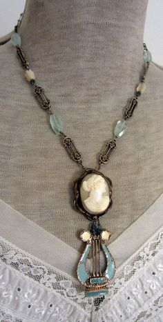 vintage assemblage necklace with shell cameo, enamel lyre pendant and aquamarine by the french circus