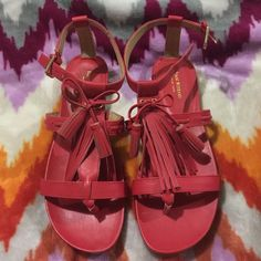 Isaac mizrahi flat sandals Isaac mizrahi flats sandals. They are women's size 8- 1/2 . They are coral red color. They are flat and open toe. The front has leather strands of tassels. New Isaac Mizrahi Shoes Sandals