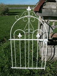 We are very proud of our wrought iron handmade gates made by Don Lawless. These welded metal gates are solid and heavy to last a lifetime. This