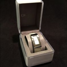 SALE!!  DKNY Ladies Watch Pearl white leather band. Silver, rectangular bezel. Ladies watch. Comes with original box as shown. DKNY Accessories Watches