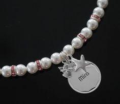 https://www.kinderschmuck-silberschmuck.de/Taufschmuck/Stern-Fisch-Taube/Taufkette-first-pearls-mit-Amhaenger::1136.html