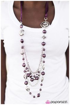 A silky purple ribbon replaces a traditional chain to create a timeless look. Pearly deep purple beads and funky silver pieces intermix with varying lengths of silver chains to give a fresh take on a Victorian-inspired piece.  Sold as one individual necklace. Includes one pair of matching earrings.