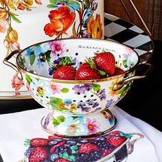Flower Market Small Colander - White: For kitchen preparations with personality, look no further. Fill with veggies grown in your own garden or hand-picked strawberries for a pleasing hostess gift. Each Flower Market Small Enamel Colander is decorated with hand-applied fanciful botanical transfers that recall a lush English garden in the peak of summer.