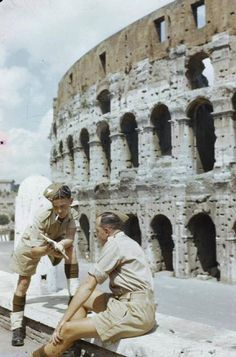 Allied troops consult a guidebook outside the Colosseum after liberation in 1944