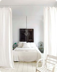 .// love the simple curtain to separate areas -- clean, breezy look