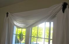 Use rolls of vinyl (that party tablecloth material) for drapes and decorate them with plastic ivy or grapes!
