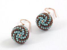 Beaded Bead earrings Turquoise & Chocolate Copper Earring Hooks  Bali-style  Turquoise  Brown Copper Minimalist Modern Beadwork. $19.50, via Etsy.
