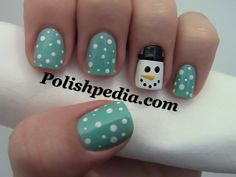 snow man nails..I could do this! I have blue nailpolish and white and black nail art brushes :) Maybe I could do these this year?