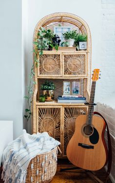 This rattan shelf in the living room is a tie for the couple's favorite element of the apartment (it competes with the bedroom's Peacock chair).
