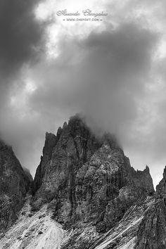 Dolomites mountain ridge in clouds