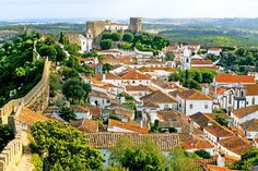 Óbidos, Portugal Whitewashed houses line Óbidos's crooked cobblestone streets, where traditional restaurants serve octopus salad and the Portuguese drink ginjinha. The historic heart of the city is its 12th-century castle, which was converted into a medieval-inspired boutique hotel in the 1950s