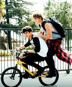 Calum & ash riding on a bike weee