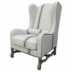 """Breezy and beautiful, this wood-framed wingback arm chair is wrapped in off-white linen upholstery accented with an indigo stripe. A complementing bolster pillow offers an extra touch of comfort.   Product: ChairConstruction Material: Linen and woodColor: Off-white and indigoFeatures: Lumbar pillow includedDimensions: 47"""" H x 36"""" W x 30"""" D"""