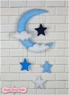 Handmade felt baby boy nursery moon and stars decoration.
