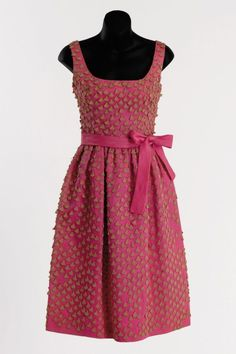 "A hot pink cocktail dress created by Hubert de Givenchy for ""Breakfast at Tiffany's"" (1961)"