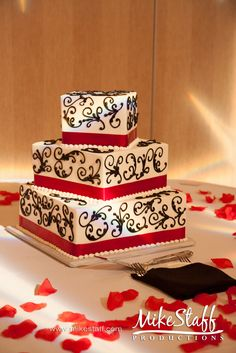 Wedding Cake Idea for Black, White, & Red Wedding. I like that's it's not straight