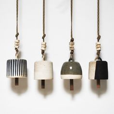 Stoneware wheel thrown bells are assembled with faceted beads and hang from hemp rope. Knocker is made of reclaimed wood. Safe to hang outdoors....