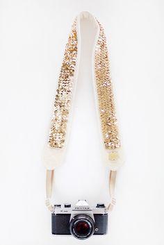 Glittery Gold Camera Strap - Rock on Gold Dust Woman! You'll be the cutest photog on the block with this glamorous camera strap.