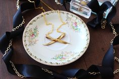 DIY Gilded Bow Necklace - Darby Smart