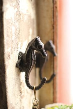 """This lovable seahorse shaped cast iron hook will cleverly hold your keys, coats, and beach bags! Hardware not included. 2"""" x 5""""t"""