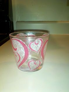 Valentine candle cups! I used empty Ikea candle glasses and Victoria's Secret tissue paper and Mod Podge