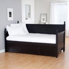 Keep it simple and super-comfy with the Casey Daybed in Black, a stunning, traditional daybed in a black rubbed finish. The sides and back are solid wood panels enhanced by a cottage beadboard design. Classic rounded finials finish off each post. The Casey Daybed is great for a guest room or bedroom, but it also makes a fine sofa for any office area. Comes with an optional roll-out trundle drawer: you can put a mattress inside and the drawer becomes and instant bed for a friendly sleepover.