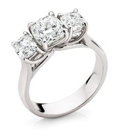 18ct White Gold 3 Diamond Ring      3 round brilliant cut diamonds set in curved 4 claw round wire settings on a flat upswept shoulder band..       Centre diamond from 0.40ct.