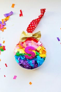 DIY rainbow confetti ornament - such fun and colorful Christmas décor! Holiday Crafts For Kids, Christmas Crafts For Kids, Diy Christmas Ornaments, Christmas Decorations, Christmas Décor, Christmas Brunch, Shape Crafts, Teacher Christmas Gifts, Diy Weihnachten