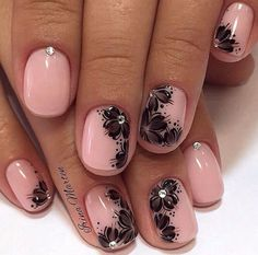 This nice pink manicure with flower print will ideally suit for visiting some evening events and festivals. On a pink base black flowers are painted, giving the manicure the saturation and brightness. The sparkling rhinestones make the idea complete, and dilute the design with brightness and contras…