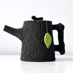 """""""Wood You Like a Cup of Tea?"""" pseudo-wood black clay teapot by Jakob Solgren"""