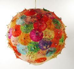 Paper lantern of cocktail umbrellas by katharine
