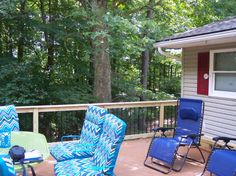 A gorgeous Timber Tech composite deck with wooden rails and Deckorator aluminum pickets.