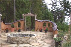 A Cob courtyard! http://freshpeekhouse.com/images/cob/leewall.jpg
