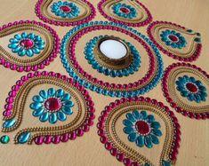Gran colorido indio Rangoli en Paisley funciones por Kalakruti