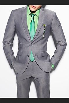 Grey suit green accent