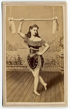 "Cabinet card publicity photo for an unknown trapeze artist, circa 1875. Inscriptions and markings, written in pencil on the reverse: ""Leora Dare? Trapeze Artist"" or ""Leora Pare? Trapeze Artist"" Printed on the reverse: ""J. Wood, Photographer, No. 208, Bowery, New York"""