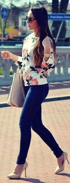 Women's Black Sunglasses, White Floral Crew-neck Sweater, Beige Leather Tote Bag, Navy Skinny Jeans, and Beige Leather Pumps