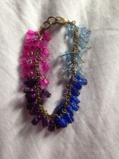 Colour wheel pink purple blue and light blue clear glass beaded charm bracelet on antique chain!   Price: £5   Warning: Please keep this bracelet dry at all times! Do not wear it in the shower or continuous water use!