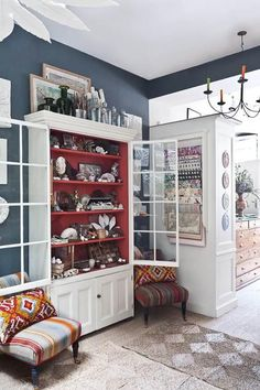 red paint inside cabinet from Ben Pentreath's shop via remodelista.