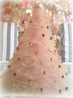 pink tulle tree with tiny glass ornaments, I so remember these lol............