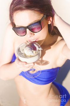 Attractive Woman Wearing Fashion Sunglasses And Blue Bikini Toasts To Her Luxurious Travelling Lifestyle While On Vacation In A Getaway Holidays Escape by Ryan Jorgensen