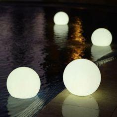 these waterproof globe lights look so pretty floating in a pool by marisa