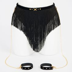 Tease your partner with these hot Sexy Black Layered Fringe Skirt Belt, with Detachable Patent Leather Handcuffs. Click link for more information on this amazing set.  http://www.labagatelle.co.uk/product/noir-skirt