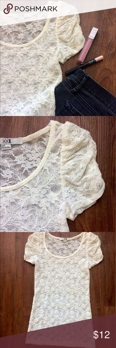 Sheer Cream Lace Short Sleeve Sheer Cream Lace Short Sleeve. Sleeves have cute ruched detailing. Shirt has gorgeous Lace flower and leaf pattern. Shirt is sheer, so I recommend pairing with a cream cami to complete the look. Worn once or twice. In excellent condition! LIKE NEW. Please make all offers through offer button! NO TRADES!! Forever 21 Tops