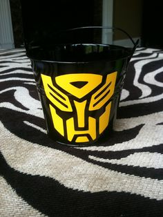 Transformer Party Favor- Children's Party Favor Buckets/ Treat Bag with Your Choice of Logo, Style 1. $2.75, via Etsy.