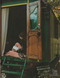 Reading in a gypsy wagon, love!!!
