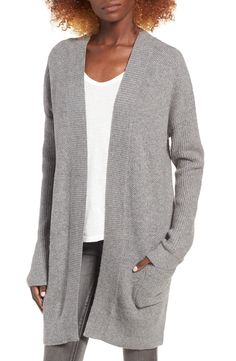 Intricate tuck stitching adds cozy dimension to a cotton-blend cardigan designed with dropped shoulders and an open front for throw-on-and-go ease. Low-slung patch pockets keep hands warm while enhancing the laid-back vibe.
